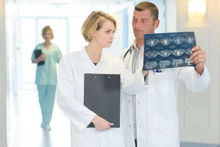 two medics with spine x-ray scan at hospital Stock Photo