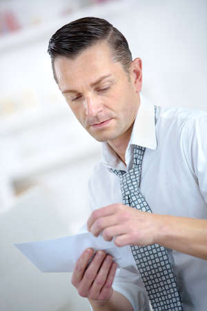 open windows: businessman opening a letter