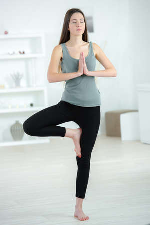 standing yoga position Stock Photo