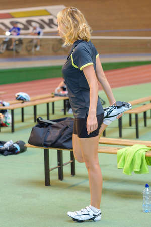 girl warming up on the athletics track