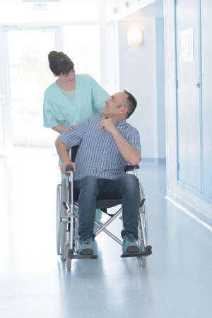 pushing the handicapped patients pushchair Stock Photo
