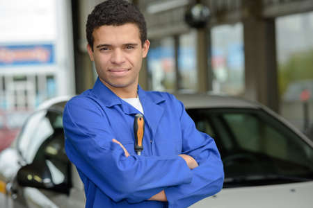 specification: working posing next to a car