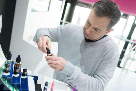 man in vaporizer shop