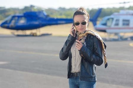 flashy: female helicopter pilot on the tarmac making a call