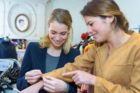 dressmaker prepares wrap detail with sketch lines