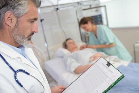 doctor reading the file