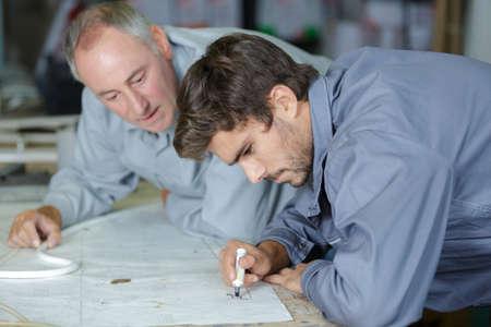 men discussing drawing