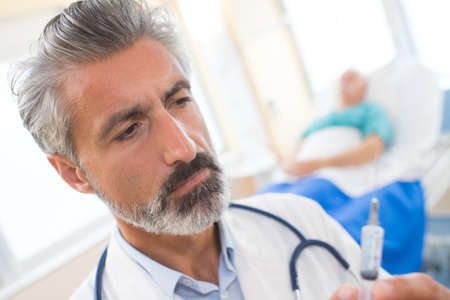 doctor with injection needle Stock Photo