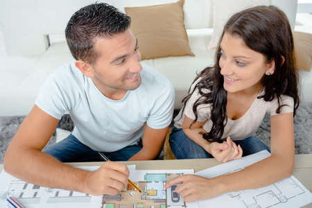 realestate: young couple looking the plans of their new purchase Stock Photo
