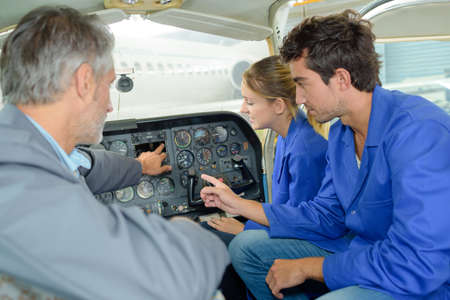 Students in aircraft cockpit