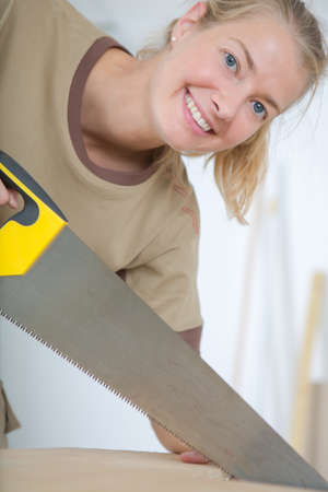 adultery: young woman happily hand sawing