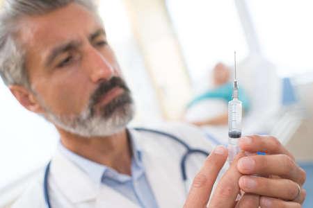 doctor preparing needle Stock Photo