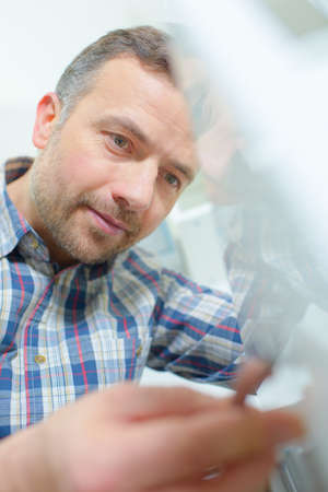 cool handsome man looking doing something Stock Photo