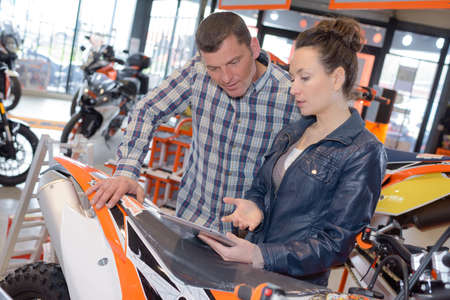 couple at a motorbike salon