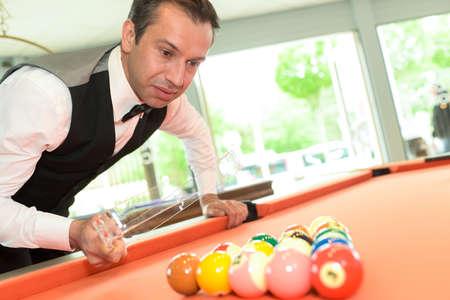 billiard: man preparing billiard balls