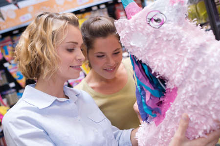friends buying a pinata for a kid birthdays party