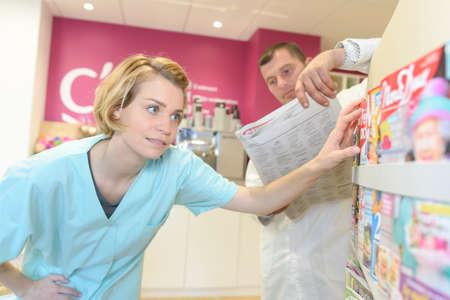 nurse buying a magazine in her break