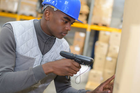 warehouseman: warehouseman scanning products ready for delivery