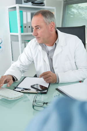 invalidity: doctor in his office Stock Photo