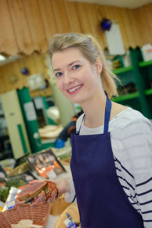 fishmonger: female fishmonger smiling Stock Photo