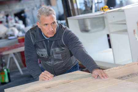 Senior man working in factory
