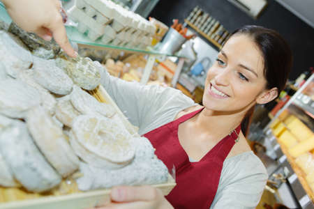 thoughtful smiling and positive worker at a bakery Stock Photo