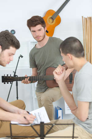 home band learning new song together