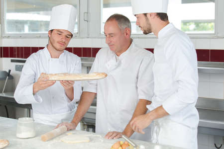 collaboration of generations in the laboratory of a bakery shop Stock Photo
