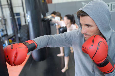 handsome masculine athlete boxer fighter training Stock Photo