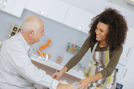 health care worker serving a meal to an elderly patient
