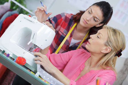 sewing machines: two women in a sewing workshop