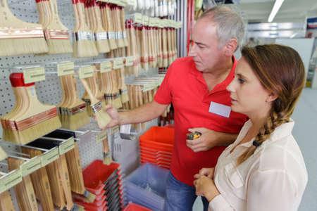 teching: assistant seller help female client choosing brush