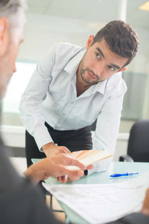 two businessmen discussing tasks