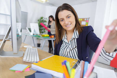construction project: pretty young graphist woman in the office Stock Photo