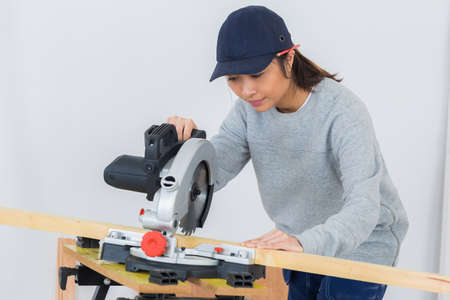 Lady using circular saw