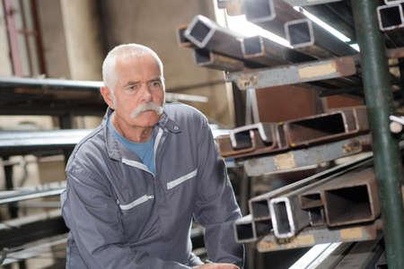 Senior man in metalworking factory