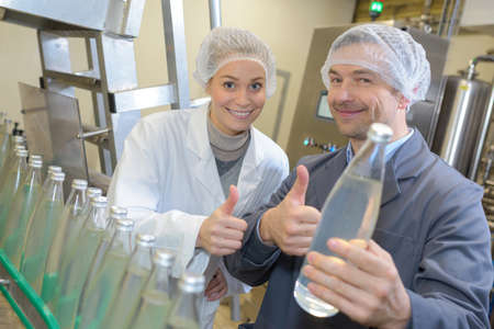 gallons: happy workers at a water factory Stock Photo