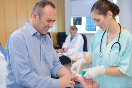 man having pain while having blood test