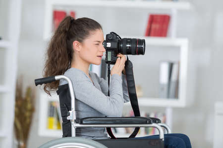 female photographer on wheelchair
