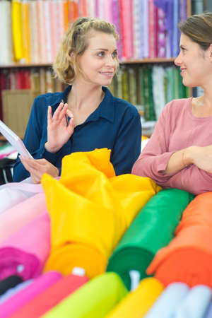 choosing textile material at a fabric factory