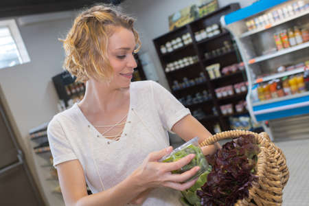 swoman choosing veggies at supermarket