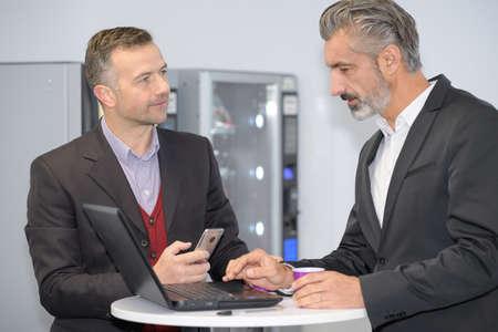 businessmen having tea in office after meeting