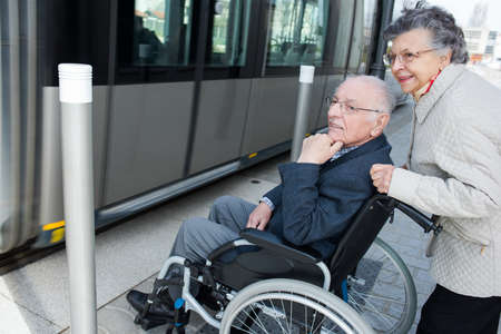 old couple waiting to get in the tram 版權商用圖片