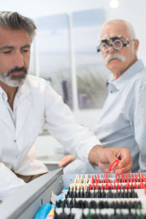 an older man taking an eye test examination