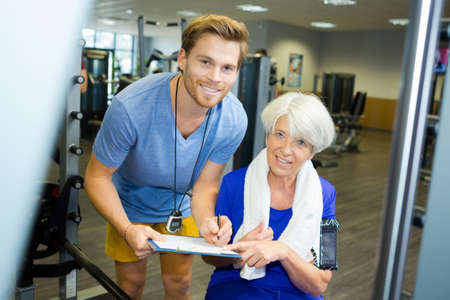 old woman training on gym training Stock Photo