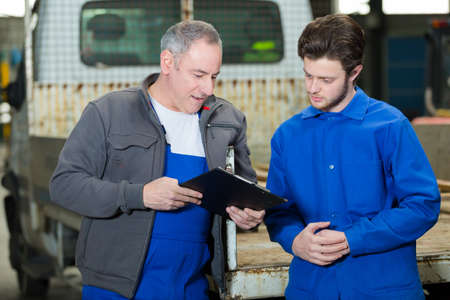 A professional and a teenager in an apprenticeship