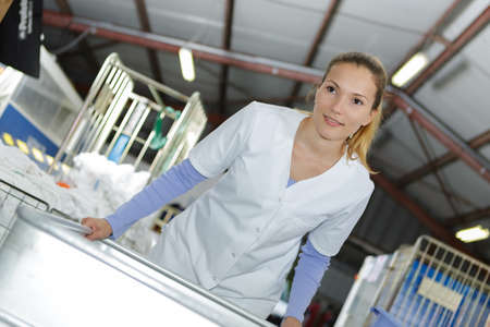 woman and washing machine Reklamní fotografie