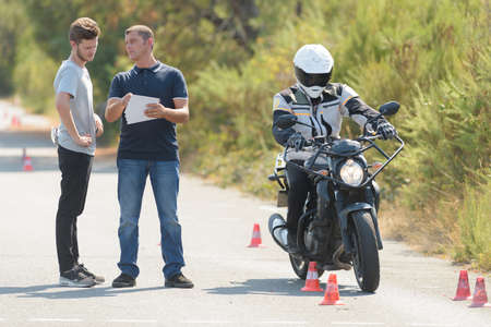 man driving instructor talking before the exercise in motordrome