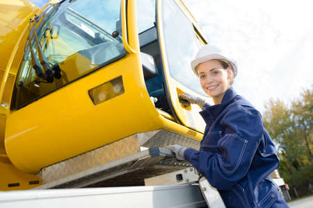 femel crane operator at work Banco de Imagens