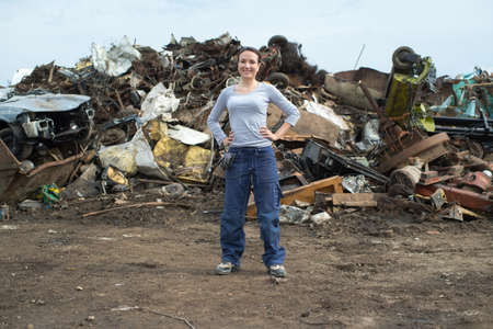 female worker posing at a scrap yard